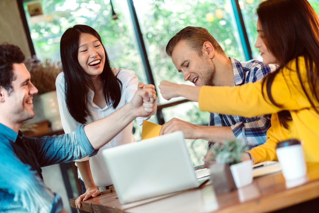 happy team boosts work performance