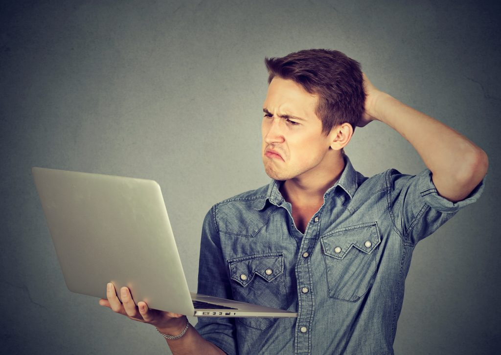 man thinking how to check if website is safe