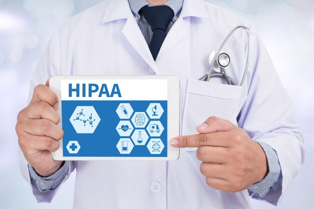 doctor applying HIPAA law about patient privacy protection