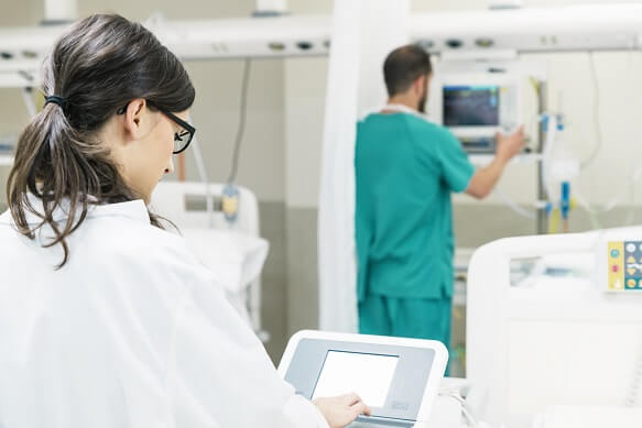 doctors using electronic equipment