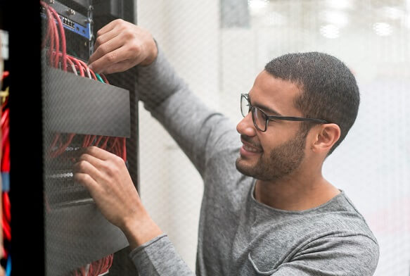 IT technician fixing a server