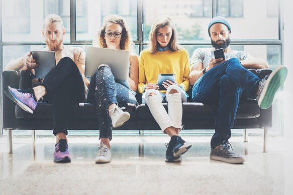 four people using different devices
