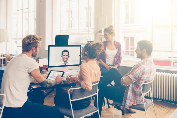 group of colleagues having online video chat