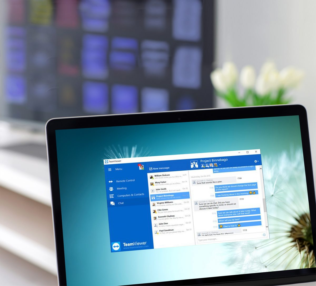 laptop screen displaying windows remote desktop and instant messaging by TeamViewer