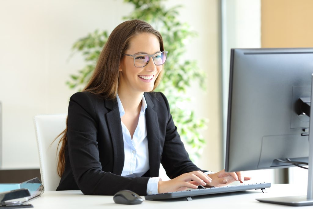 smiling woman providing customer service with TeamViewer customer relations management tool