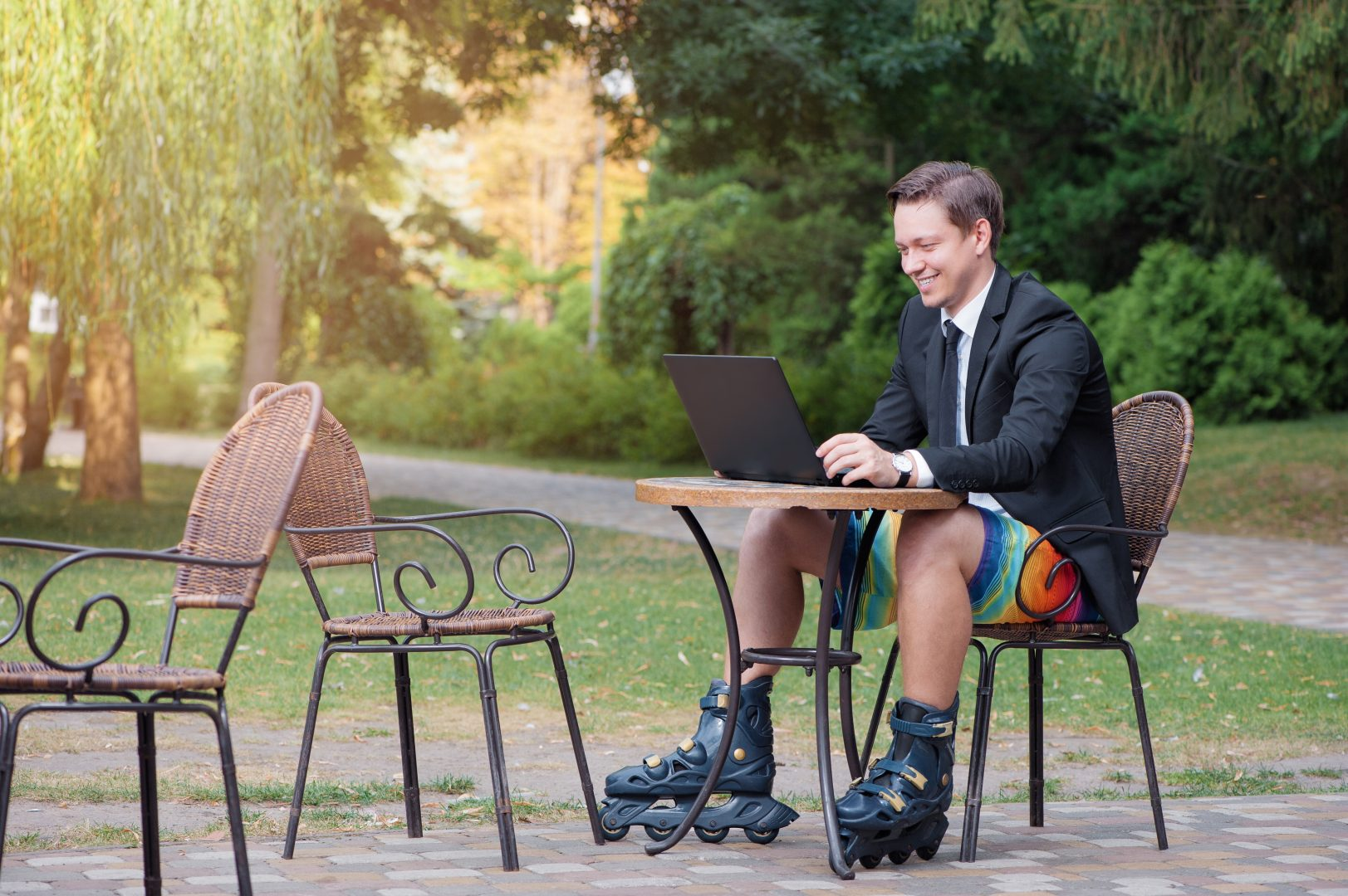 relaxing man work remotely outdoor wearing skates shoes